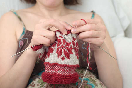 avocation: Caucasian woman hands  needle knitting snowflake pattern Stock Photo
