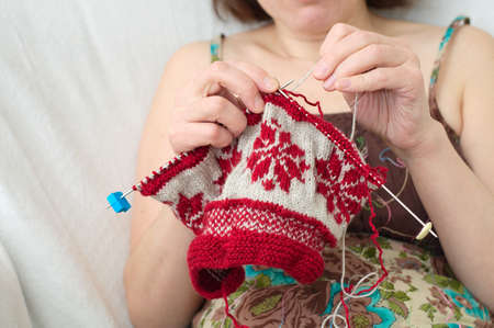 avocation: Caucasian woman craftwork knitting with the needle