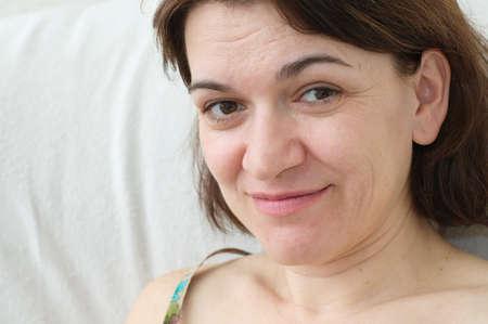 forties: Beautiful caucasian woman portrait smiling  in her forties