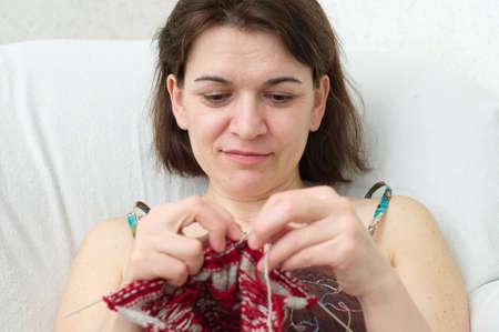 avocation: caucasian woman enjoying with yarn needle knitting   Stock Photo