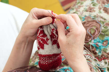 avocation: woman hands  knitting with needle yarn  snowflake pattern Stock Photo