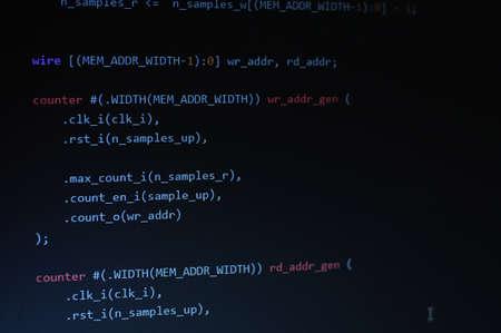 develope: Program coding on display on dark background
