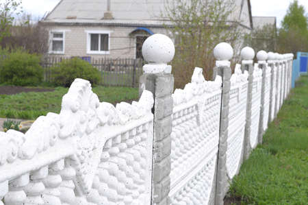 armoring: Concrete fence in outdoor decoration of cottage