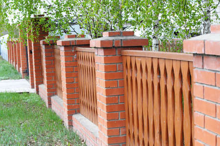 palisade: palisade fence with red brick columns in house decoration