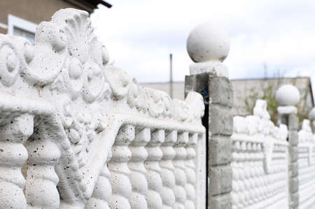 armoring: Guss concrete fence in outdoor decoration of cottage