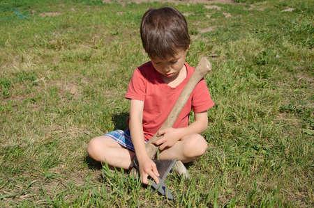 gad: Boy learning in ax edge blade sharpening
