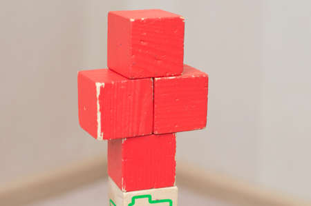 red cross: Red cross of toy cubes builded by kid