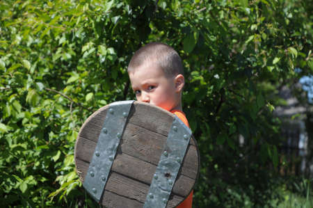 buckler: Boy playing role of young warrior with buckler