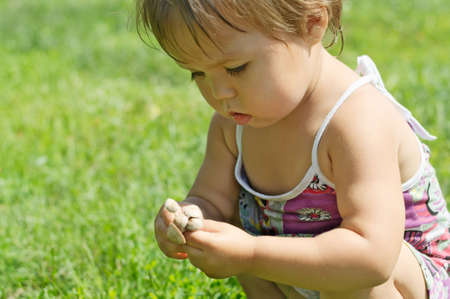 Little girl playing with toxic toadstool mushrooms