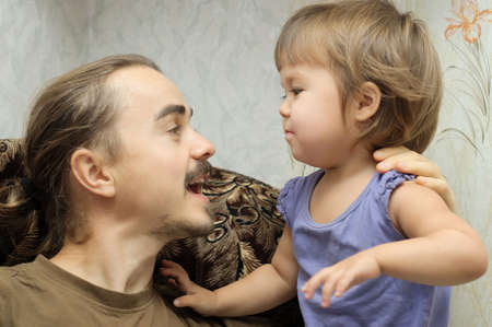 canvass: Father and little daughter communicating actively Stock Photo
