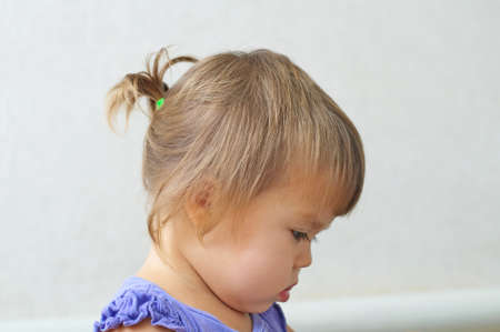 ponytail: Child girl first hair style - tiny ponytail, profile of baby girl