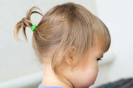 ponytail: first hair style: tiny ponytail, profile of baby girl child