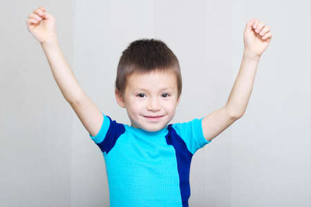 toothless: happy boy greeting with hands up, toothless child Stock Photo