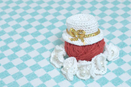 knitted hat, knitted flowers and ball of yarn, clothing and accessories decoration elements