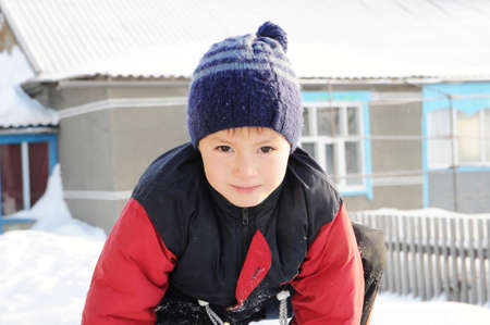 warm clothes: Winter activity - boy portrait at winter playing outdoor in warm clothes