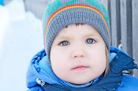 warm clothes: Little girl portrait face outdoor at winter in warm clothes