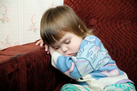 Exhausted child sleeping on chair, tired kid fall asleep after playing
