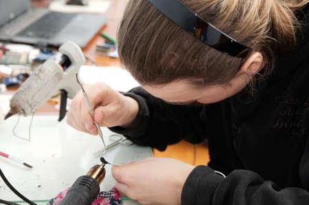 animal figurines: man sculptor making handmade miniature plastic toy, house decoration craftsmanship hobby, decor creation process Stock Photo