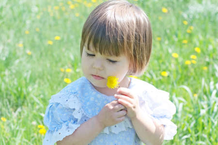 Little girl in summer with dandelion flower. Cute child adorable and beautiful enjoy nature.