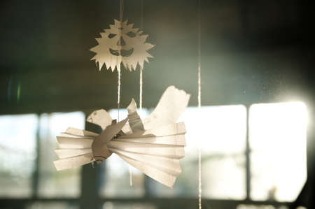 frightful: Figure of paper pigeon birds and Halloween paper face on sunny background on fiber