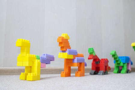 Dinosaur figurines made with plastic constructor block kit toys Stok Fotoğraf - 89491473