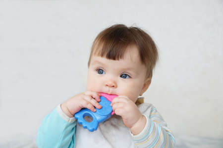 Teether toy for infant. Baby milk teeth growing and scratching. temporary first tooth of child