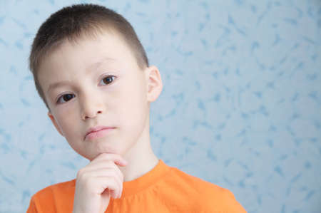 Idea thinking adorable boy portrait closeup, solving problem concept Stock Photo