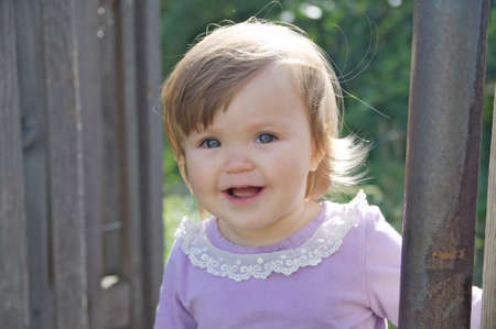 Cute baby girl happy smiling portrait. Adorable emotional child outdoor in park Фото со стока - 109862073