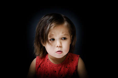 Child afraid in dark. fearful little girl tremble at something in night Stock Photo