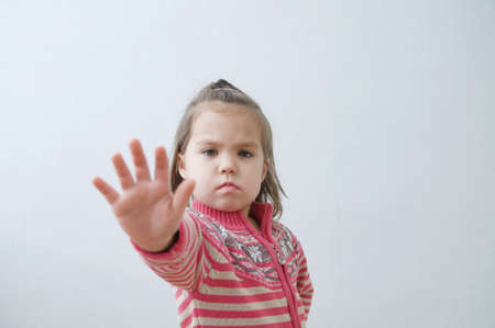 stop sign, toddlers palm saying stop with hands in front of himself. suspend of constraint on children. Kids protection.