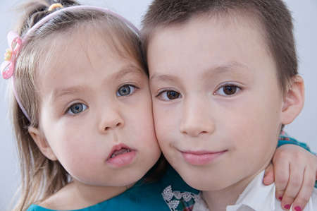 Happy children. Boy and girl portrait. Children close up faces. Siblings together