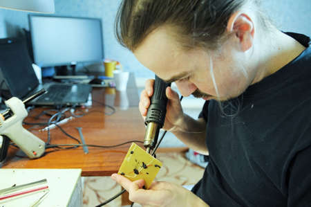 figurine making. young man sculpting handmade toy bee from plastic glue, house decoration craftsmanship hobby, decor creation process 스톡 콘텐츠