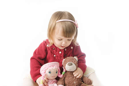 playing little girl. cute caucasian baby with bear and doll isolated on white background 스톡 콘텐츠