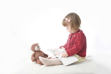 education concept. playing school with toys. happy smiling baby girl elegant in dress. cute caucasian baby with teddy bear 스톡 콘텐츠