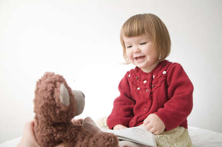 Story time. Little girl playing with teddy bear and doll. children education and happy childhood 스톡 콘텐츠