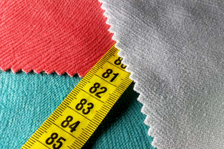 colored measuring tape on background