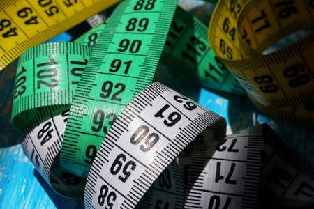 measuring tape on blue background Banco de Imagens