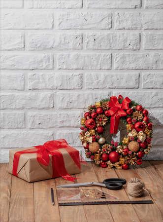 Christmas wreath on wooden table. Christmas decor handmade. Top view