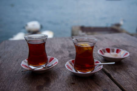 two thin specific cups of tea waiting to be drink on wooden table Stok Fotoğraf