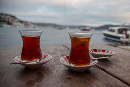 two thin specific cups of tea waiting to be drink on wooden table Imagens