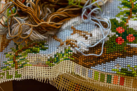 Cross-stitch handle is very colorful and tasteful