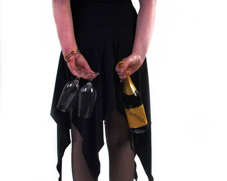 Young woman hiding champagne behind her back photo