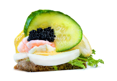 danish open sandwich with egg, caviar and shrimps photo
