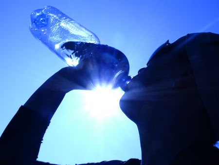 woman drinking water in the sun photo