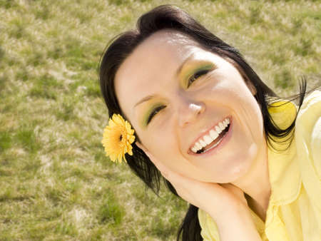 smiling woman with flower in the garden Stock Photo - 4712185