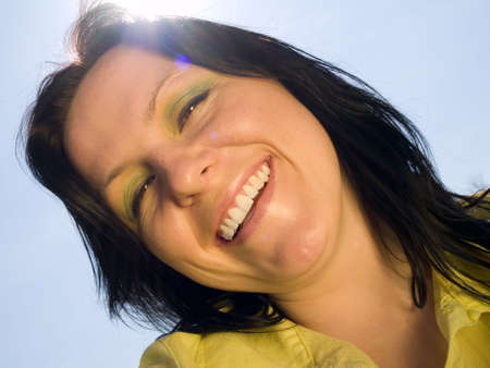 smiling, active woman on the blue, sunny sky Stock Photo - 4712200