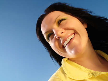 smiling, active woman on the blue, sunny sky Stock Photo - 4712202