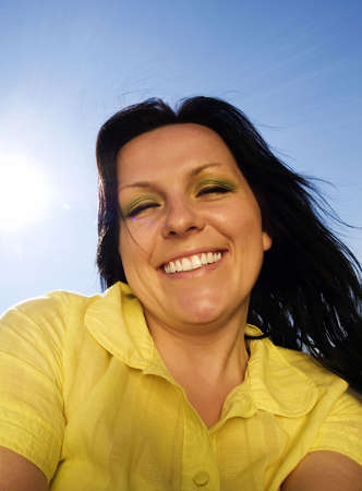 smiling, active woman on the blue, sunny sky Stock Photo - 4712197