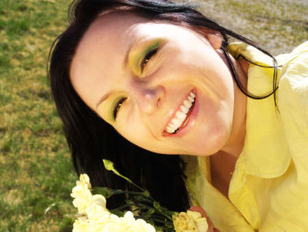 smiling woman with flower in garden Stock Photo - 4712205