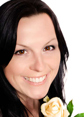 smiling brunette woman with rose photo